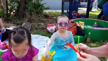 Chris Frost's daughter in an Elsa costume wearing star shaped sunglasses