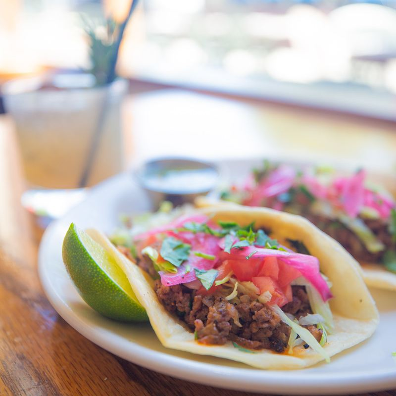 Delicious street tacos made with impossible burger meat substitute, pickled onions, lime, and corn tortillas served at McNear's Saloon and Dining Hall