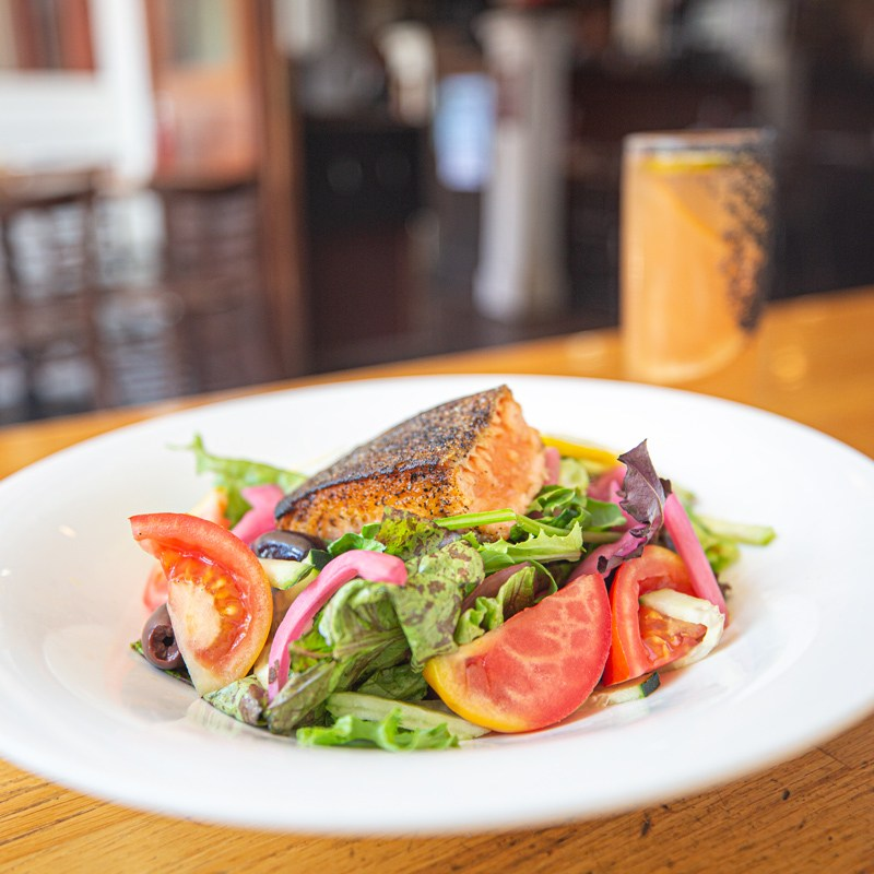Delicious salmon salad with fresh tomatoes and spring green lettuce served at McNear's Saloon and Dining Hall